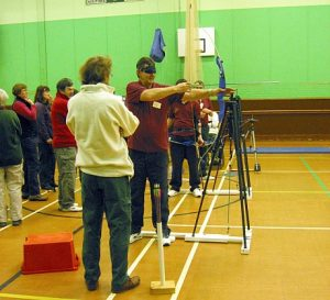 Disability archery - a blind archer takes aim
