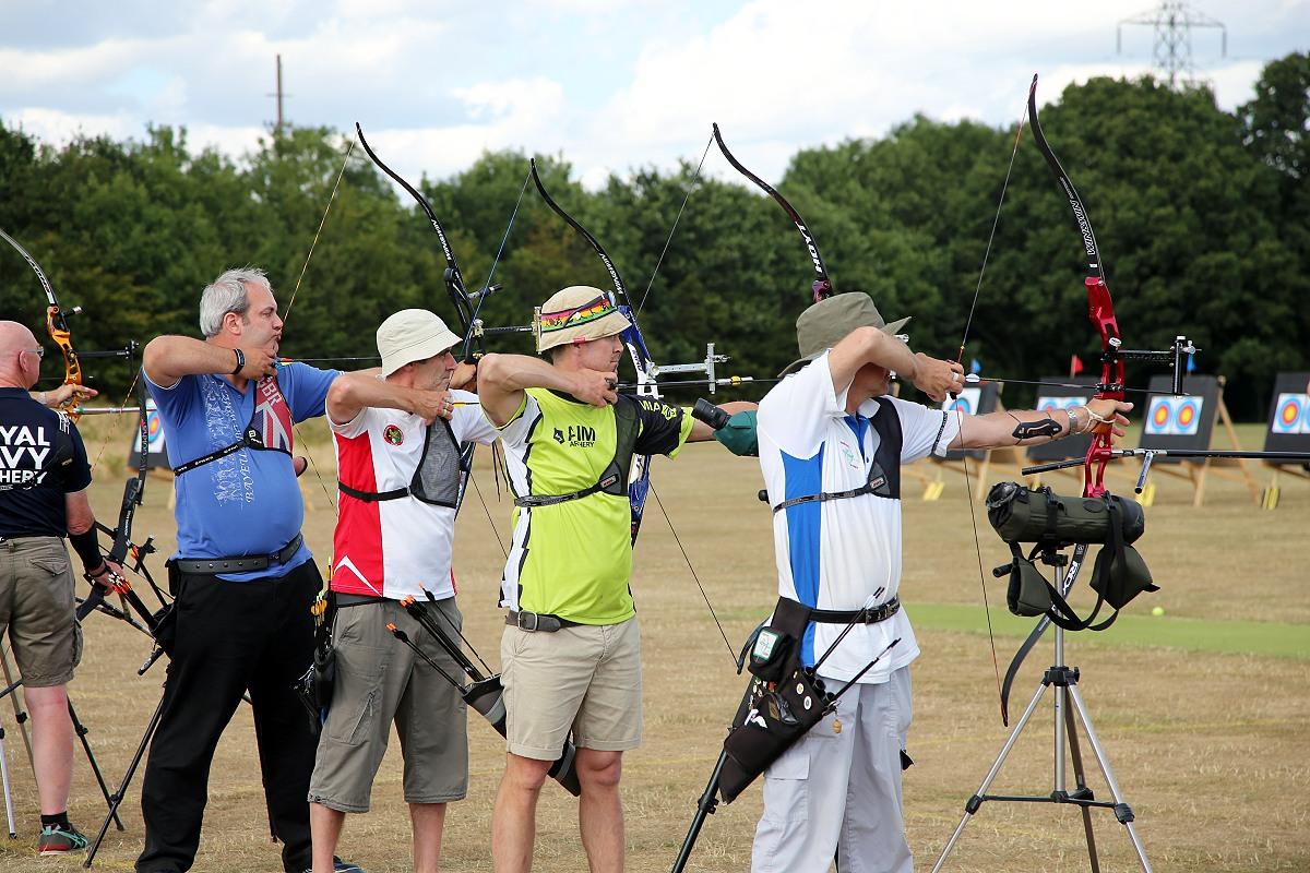 Recurve archers taking aim
