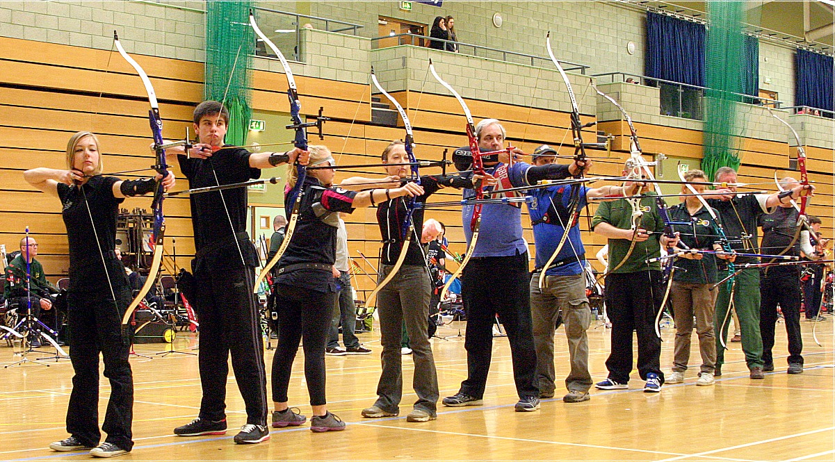 Recurve archers competing indoors